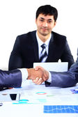 Businessman shaking hands to seal a deal with his partner — Stock Photo
