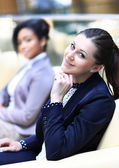 Businesswomen Sitting In Modern Office and discuss business matters — Stock Photo