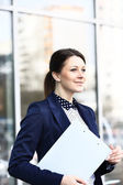 Young business woman in the big city purposefully looking away. — Stock Photo