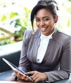 Businesswoman Sitting In Modern Office Using Digital Tablet — Stock Photo