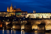 Castle and Charles Bridge by night in Prague — Stock Photo