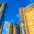 Stock Photo: High-rise building on background of blue sky