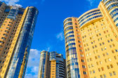 High-rise building on a background of blue sky — Stock Photo