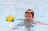 Boy with a ball in the pool — Stock Photo