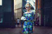 Beautiful stylish young woman on a street — Stock Photo