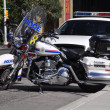 Stock Photo: Police cruiser and motorcycle