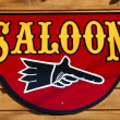 Old saloon sign - Stock Photo