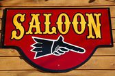 Old saloon sign — Stock Photo