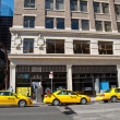 Yellow cabs line up — Stock Photo