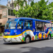 Постер, плакат: Colorful tourist bus on Kalakaua
