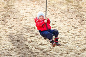 Boy at the swing — Stock Photo