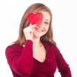 Woman holding heart shape to her face — Stock Photo #18503395