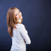 Smiling woman sidewise with crossed arms — Stock Photo