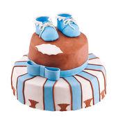 Isolerade tårta med baby bootee — Stockfoto