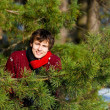 Stock Photo: Young msmiling in winter forest