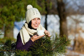 Young smiling woman drink tea in winter forest — Stock Photo