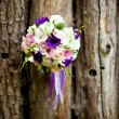 Stock Photo: Closeup of brides flowers on wedding day