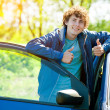 Smile man near blue car — Stock Photo