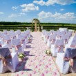 Wedding ceremony set up in garden - Stock Photo