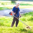 Senior man with lawn mower — Foto de Stock