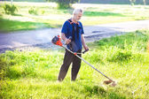 Senior man with lawn mower — Stock Photo