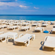 Lounge chairs by the sea — Stockfoto