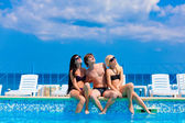 Happy friends by the pool — Stock Photo
