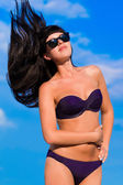 Beautiful girl in bikini with flying long hair — Stock Photo