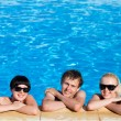 Friends in the swimming pool — Stock Photo #26301369