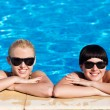 Beautiful females model posing by the pool — Stock Photo
