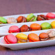 Colorful macaron on the plate - Stock Photo