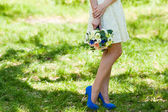 Bride with Closeup of wedding flowers — Stock Photo