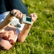Woman in glasses in outdoor taking a picture of themselves — Stok fotoğraf