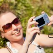 Woman in glasses in outdoor taking a picture of themselves — Stock Photo