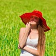 Summer portrait of beautiful girl wearing red hat — Stock Photo