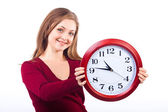 Young smiling woman isolated on white background holding a clock — Stock Photo