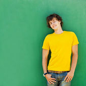 Man with curly hair in a yellow T-shirt — Stock Photo