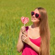 Young beautiful girl in glasses in the field — Stock Photo