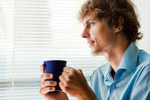 Man with a cup of tea in office — Stock Photo