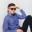 Handsome fashion man wearing sunglasses thinking — Stock Photo