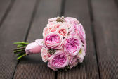 Beautiful delicate bridal bouquet on texture background — Foto de Stock