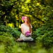 Beautiful girl with peonies in the forest — Stock Photo #41883161