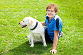 Curl smiling Man with his dog outside — Stock Photo