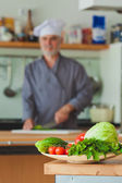 chef preparing vegetables in his kitchen — Stock Photo