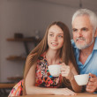 Senior man with drinking cofee with beautiful woman — Stock Photo #47663391
