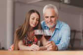 Couple holding wine glasess — Stock Photo