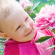 A small child in the garden — Stock Photo