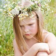 Stock Photo: Resentful little girl in wreath of flowers