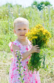 The little girl in wildflowers — Stock Photo