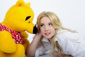 Beautiful girl with plush bear — Stock Photo